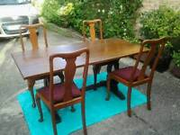 Solid oak dining room table plus 4 X oak dining room chairs. Also old trunk