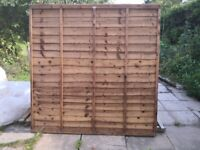 New lapped fence panel and concrete post