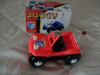 Buggy car including box, battery operated flip over car