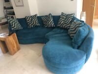 Blue and grey curved settee and cushions