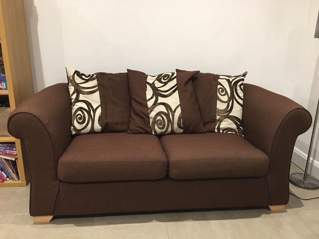 Brown 2-seater sofa bed (DFS)