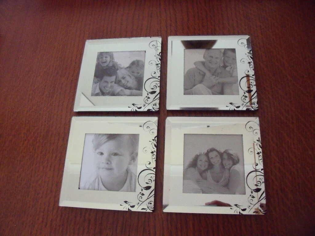 NEW in original packaging 4 mirror photo coasters with black wooden holder. £3 ovno
