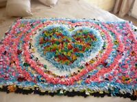 BEAUTIFUL HANDMADE RAG RUG, WOULD SUIT A NURSERY OR BEDROOM GREAT BABY SHOWER GIFT. HEART PATTERN.