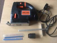 New unused jigsaw with carry case, fence, vacuum adapter and blades, 710 watt