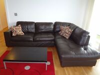 Dark brown leather effect corner sofa to be collected from Salford Quays