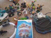 Wii console 2 controllers skylanders game and 16 skylanders figures