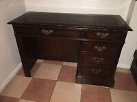 Dark wooden solid vintage desk, leather top, good quality
