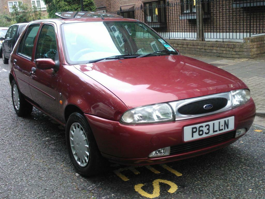 ford fiesta ghia 16v 1996 p reg met red 5 door hatchback 5 speed manual pas a c 28k fsh. Black Bedroom Furniture Sets. Home Design Ideas