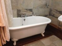 Lovely cast bath tub with feet and taps
