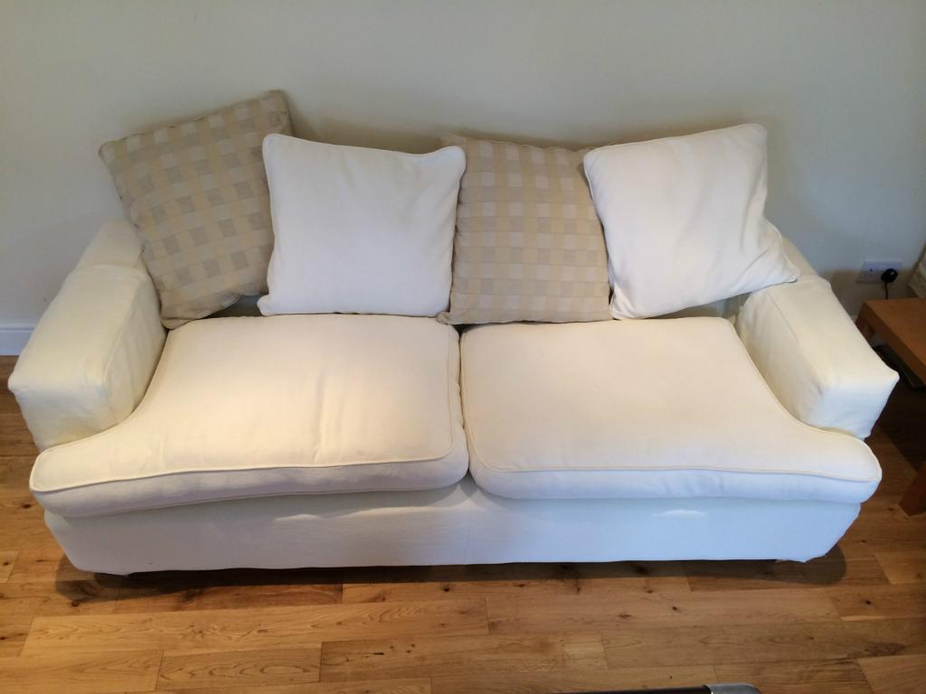 Dfs 3 and 4 seater cream fabric sofa for sale united for Cream sofas for sale