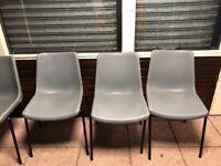 24 grey plastic chairs