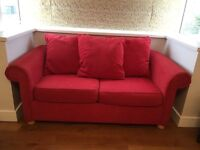 Red Double sofa bed, excellent condition . Wooden legs and three loose cushions.
