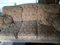 Three piece suite. Three seater sofa and two chairs