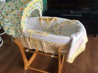 Moses basket, rocking stand, mattress and a coverlet.