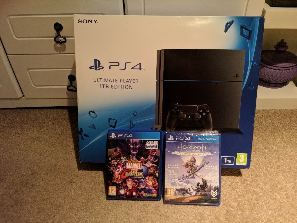 PS4 1TB (New and sealed) + 2 Games