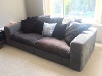 Very large three seater charcoal grey fabric sofa / couch