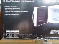 Brand new and unused Russell Hobbs microwave oven