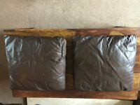 Two leather cushions
