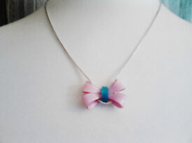 Claire's Accessories Silver Toned Necklace with a Pink and Blue Acrylic Bow.