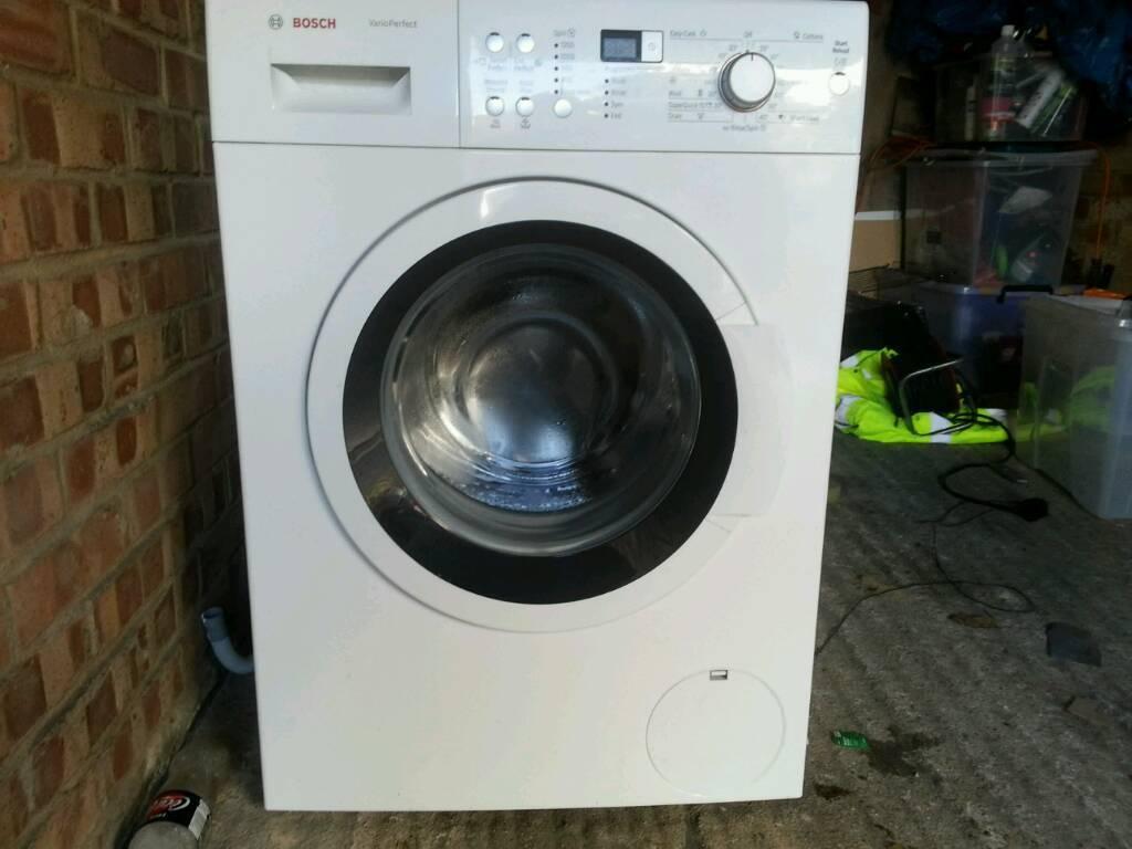 white bosch washing mashine 8kg drum