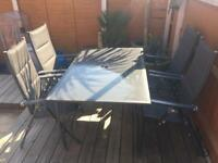 Garden table and rattan chairs **Good sturdy quality**
