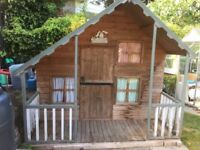 Large wooden play house with outside veranda and internal mezzanine