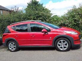 2009 Peugeot 207 SW outdoor 110 Red Estate. Diesel. 5 seats.