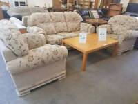 Beige patterned fabric three seater sofa with 2 chairs