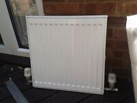 "Brand new radiator, never used, inc wall brackets, radiator measures 20""x20"""