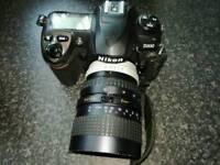 Nikon D200 DSLR + lens.
