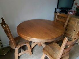 A COLLECTION OF DINING TABLE AND CHAIRS