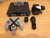 Nintendo 64 console, controller and mario 64 game.