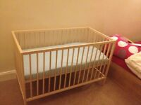 IKEA cot with mattress and bed sheet