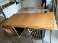 Table, two carver and six dining chairs great conditoon