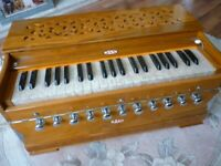 very beautiful quality indian jas harmoneum,has eleven tone stops in excellent perfect condition..