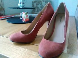 High heeled rust coloured shoes size 5