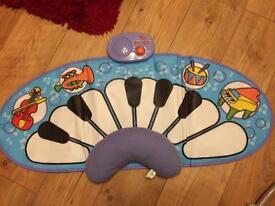 ELC tummy time piano mat