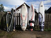 Windsurf boards, mast, harness, sails and various equipment - some still in new packaging