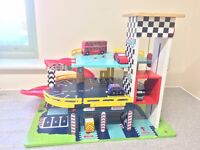 Pit Stop Toy Garage. Lovely, colourful, wooden garage with three levels and working lift.
