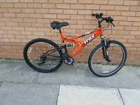 TRAX mountain bike with full suspension and 26 wheel size