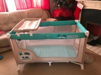 Baby travel cot with changer