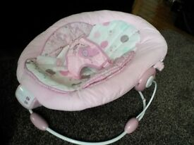 Pink Comfort and Harmony baby rocker.