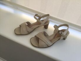 Size 5; beige colour 1.5 ins. Heel. Good condition,