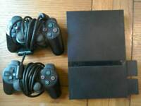 PlayStation 2 PS2 with controllers & games