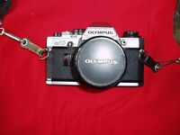 Olympus OM 10 35mm SLR camera and additional items