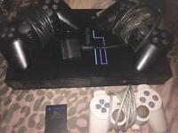 PlayStation 2 console, memory card and controllers £30
