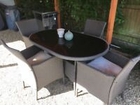 Rattan patio table and four chairs