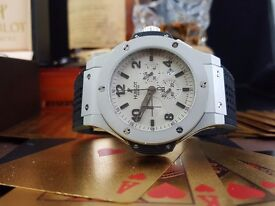 Silver Hublot Fusion With Silver Casing silver Face and Black strap Comes bagged and boxed