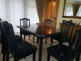 black extendable dining table and 6 chairs