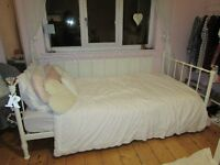 White metal frame day bed ornate with crystal knobs and matress